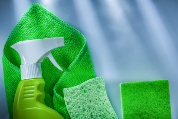 Green cleaning cloth sprayer sponge on white background